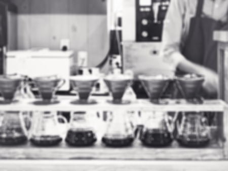 beverage display: Drip coffee with Barista Blurred background Restaurant Cafe Black and white