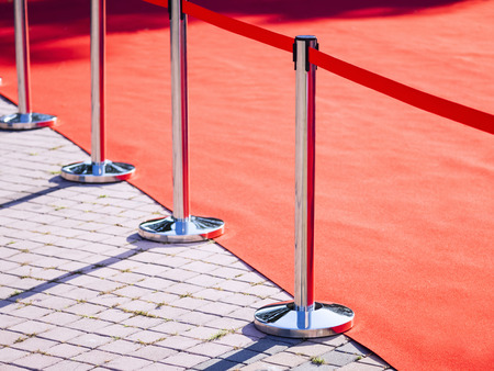 red carpet background: Red Carpet fence pole with red ropes Fashion show Event background