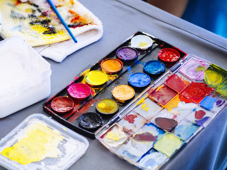 art and craft equipment: Colour Palette with Painting Arts and Brush on Table