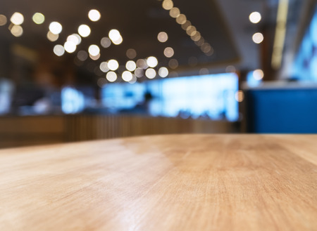 mocked: Table top with Blurred Bar Restaurant interior background