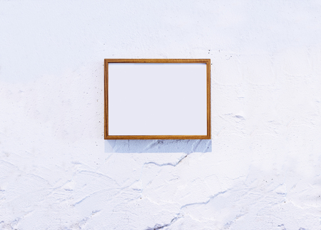 textured: Blank Wooden Photo Frame on white textured wall Background Stock Photo