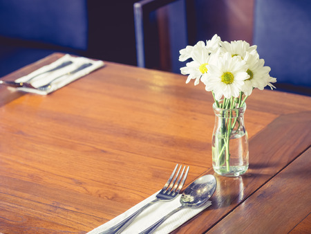 mocked: Cafe restaurant Table with white flower decoration Stock Photo