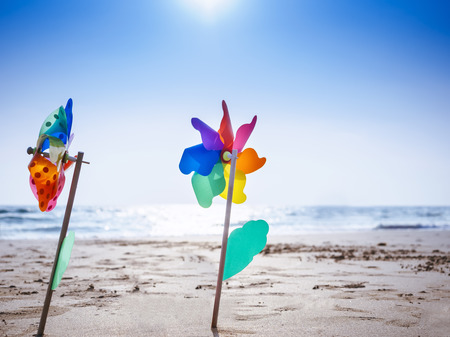 Pinwheel on sand Beach Outdoor Summer holiday background with Blue sky Фото со стока