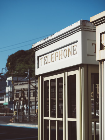 sidewalk talk: Telephone Booth Vintage style outdoor City Urban scene
