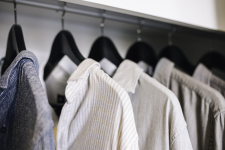 fashion clothes: Clothes hanging in Closet Shop Fashion display Stock Photo
