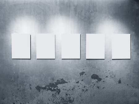 mocked: Mock up Posters frames on Grey concrete wall Gellary display with lighting decoration