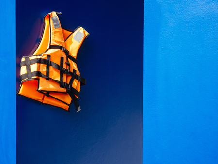 Life vest on blue wall background Safety Equipment Rescue