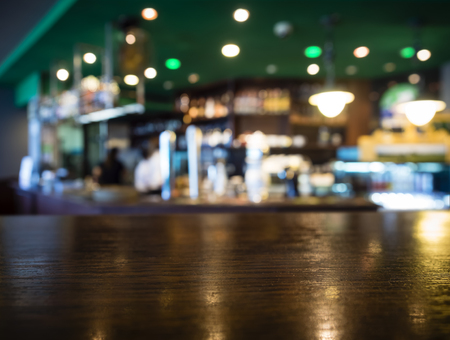 blurred background: Table top Counter with Blurred Bar Restaurant Background