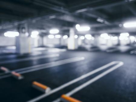 parking lot interior: Blurred car park indoor Basement with Neon Lighting Stock Photo