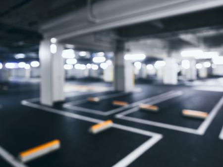 car park interior: Blurred car park indoor Basement with Neon Lighting Stock Photo