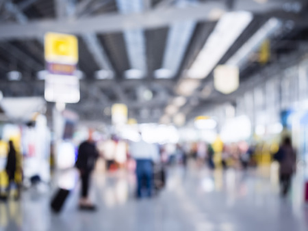 people travelling: Blurred People crowd Travelling at Airport Interior Stock Photo
