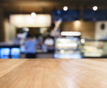 Table top Counter with Blurred People Restaurant Shop interior background Фото со стока - 58149332
