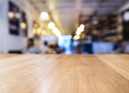 mocked: Table top with Blurred Bar restaurant cafe interior background