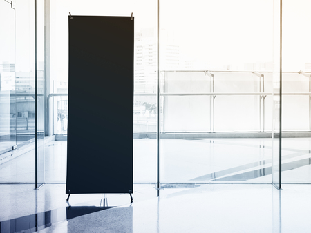 black banner: Mock up Banner Stand Black Template with Modern Interior Building Stock Photo