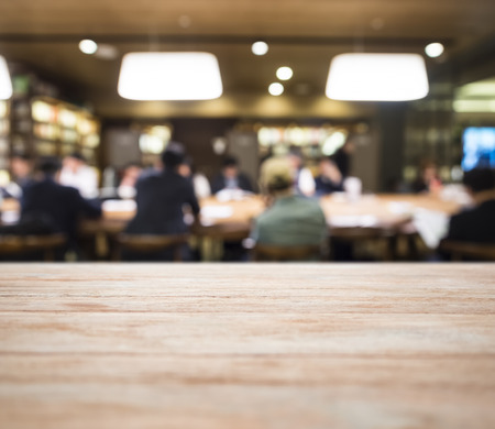 blurred people: Table top with Blurred People meeting Office interior Stock Photo