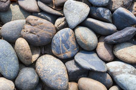 Guijarros piedra fondo natural a orillas del mar