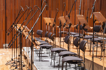 classical music: Orchestra stage instrument with chairs and microphone Stock Photo