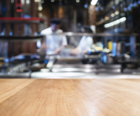 counter top: Table top counter blur Kitchen and Chef cooking background Stock Photo