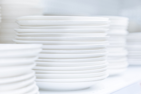 dinnerware: Dishes Plates stacked white and clean tableware