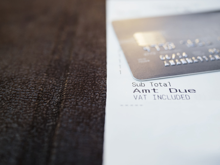 credit card bills: Shopping Receipt with Cedit card close up