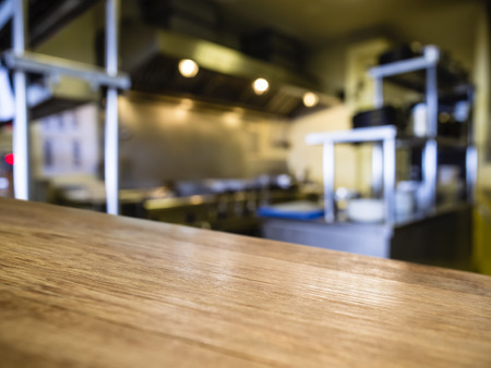 Top of Wooden Table with Blurred Kitchen Restaurant Background Stockfoto