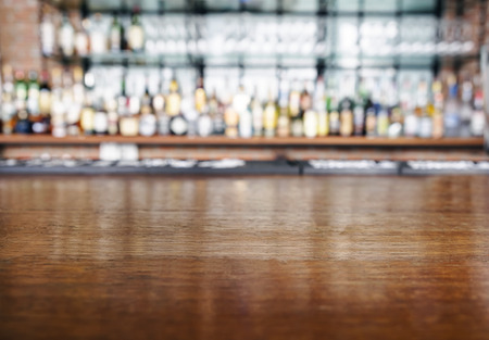 glass cup: Top wooden table with Bar Blurred Background Stock Photo