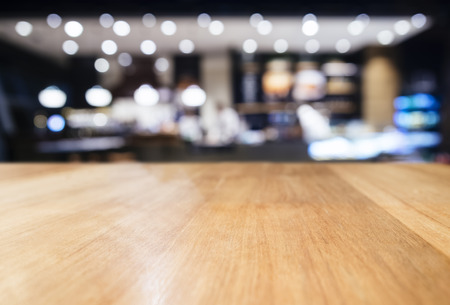 Table top counter with Blurred Bar Restaurant Lighting decoration background 版權商用圖片