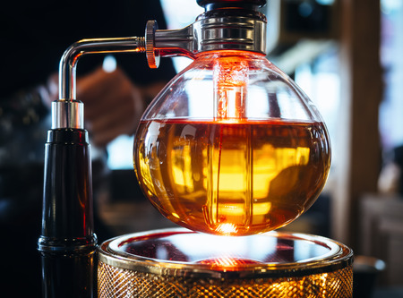 brewing: Syphon Coffee Maker Brewing coffee display Cafe Restaurant Stock Photo