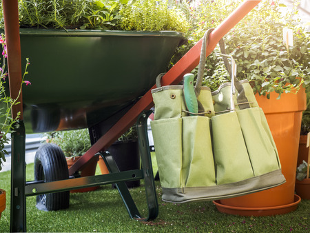 tool bag: Gardening tool Bag in green garden Summer Outdoor lifestyle Stock Photo