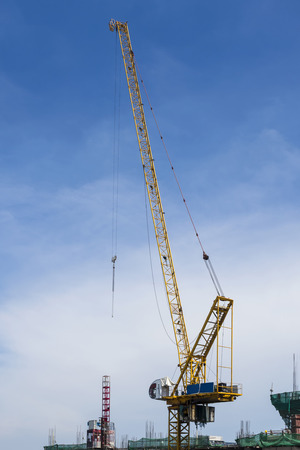 develope: Industrial Crane and construction site with blue sky