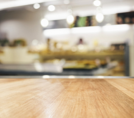 Table top with blurred kitchen interior background Imagens