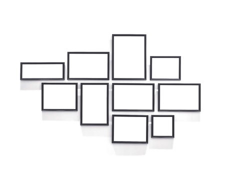 Blank Picture Frames design Template on white wall Stockfoto