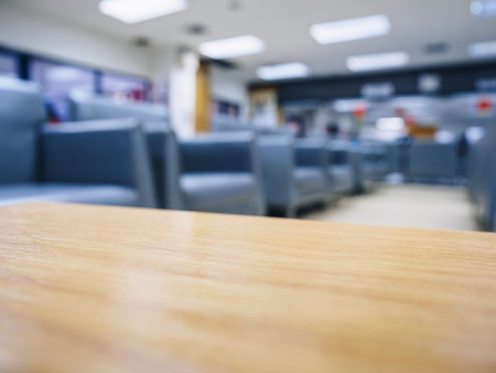 Top of table with blurred sofa waiting room office space