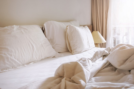 messed up: Bed sheet pillows and blanket messed up in the morning Stock Photo