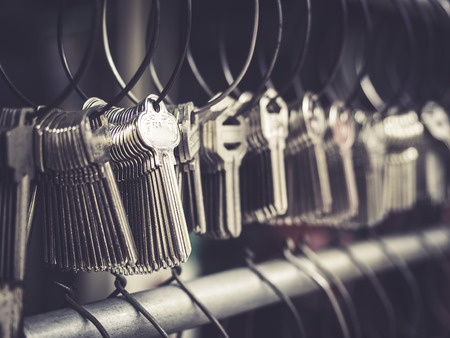 Locksmith Key shop Business Various Key chains in bunches Stock Photo