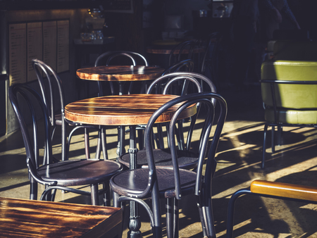 restaurant dining: Table and Chairs Seats outdoor Cafe Restaurant with morning light Stock Photo