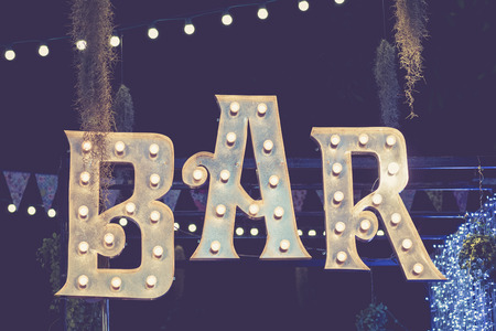 type bar: Bar signage Lights decoration outdoor Event Retro Type design Stock Photo