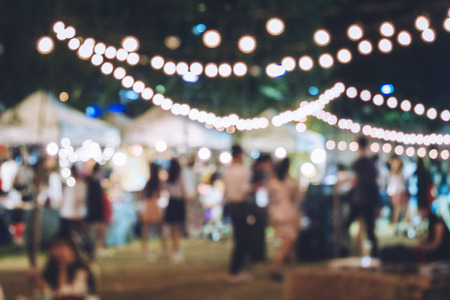 outdoor event: Festival Event Party with Hipster People Blurred Background