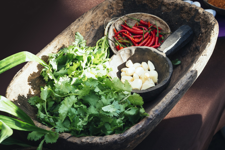 exotic food: Garlic Red Chilli Coriander in Wooden bowl Exotic food style Cooking Ingredient