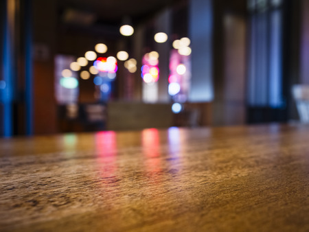 Table top Bar counter desk Blurred colourful lighting background Party event Stock Photo