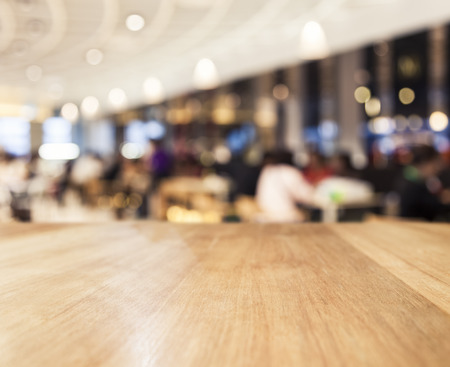 blurred people: Table top Counter with Blurred People and Restaurant Shop interior background