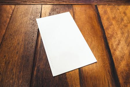 mocked: Blank Mock up Brochure Paper Menu on wooden table