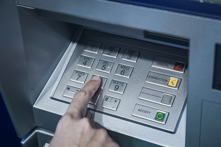 automatic teller machine: Password code protection Hand on button number Banking automatic teller machine
