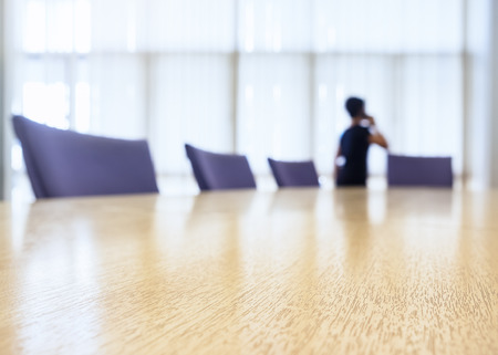 telephone interview: Table Top with Blurred People Talking on phone Boardroom meeting Business background Stock Photo