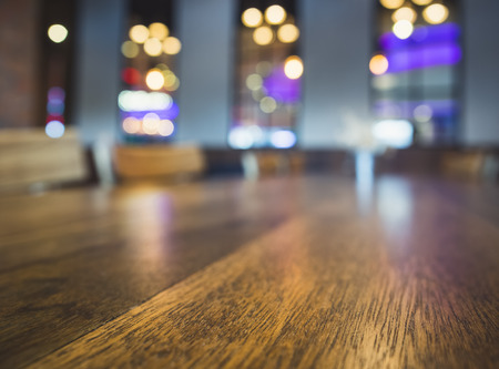 night table: Table top Bar seats Blurred colourful lighting background Party event Stock Photo
