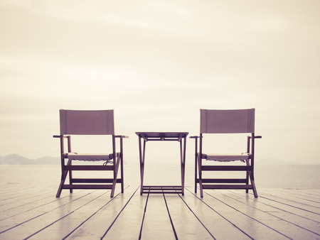 two chairs: Two chairs table set on beach sea outdoor background