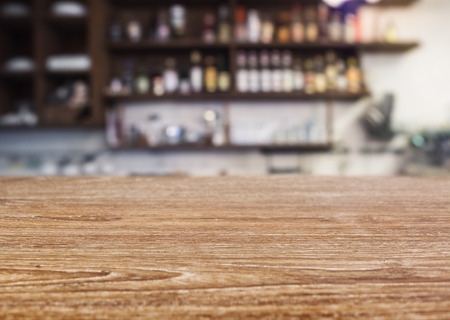 mocked: Table top Counter with Blurred Bar Shelf bottles Restaurant cafe background Stock Photo