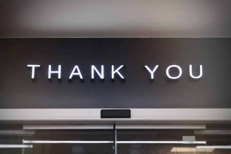shop sign: Thank you signage Shop retail display Type on Black wall background