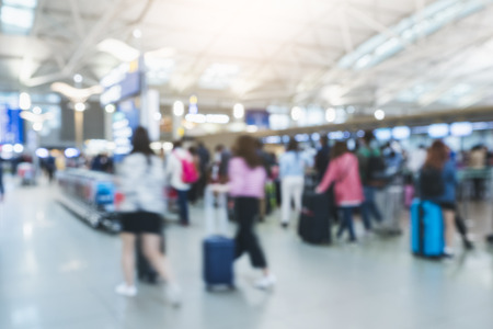airport check in counter: Traveling people walking with luggage Blur Passengers Crowd in Airport