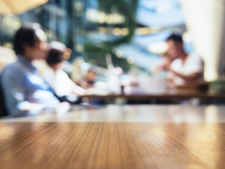 Blurred people in Cafe restaurant table Top background Foto de archivo